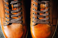 Close up of pair of men`s brown leather shoes. Lacing on shoes. Pair of men`s brown leather shoes close up. Lacing on shoes stock image