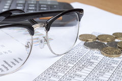 Close up of a pair of spectacles on an account's desk stock photo