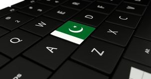 Close up of Pakistan button. Close up of Pakistan flag button on laptop keyboard Stock Photos