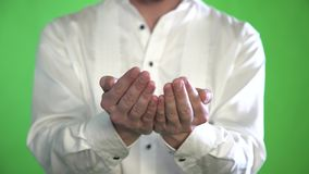 Close-up of the palm of a man in a shirt on a green background stock video