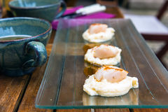 Close up of pan seared sea scallops and a cup of cider Royalty Free Stock Photos