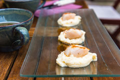 Close up of pan seared sea scallops and a cup of cider Stock Image