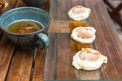 Close up of pan seared sea scallops and a cup of cider Stock Photography