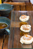 Close up of pan seared sea scallops and a cup of cider Stock Images