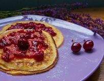 Close-up of pancakes with cherry jam royalty free stock photos