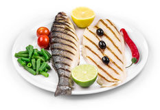 Close up of pangasius and sea bass. Royalty Free Stock Photo