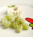 Close up Panna cotta. With grapes and sugar Royalty Free Stock Photos