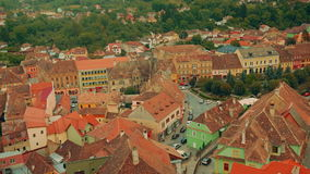 Close-up, Panoramic View of Sighisoara City in Transylvania, Romania. A close-up aerial shot of the Transylvanian town of Sighisoara in Romania. The Historic stock footage