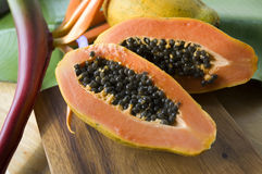 Close up papaya with seed. On wooden board Stock Photography