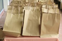 Close up paper bag of kraft brown on table.  Royalty Free Stock Photography