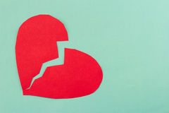 Close up paper broken heart on blue background Stock Photography