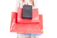 Close-up of paper shopping bags in young shopper hand Stock Photo