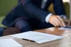 Close up of business contract on table with pen royalty free stock photo