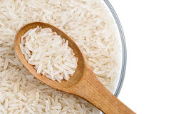 Close up of parboiled rice and wooden spoon in glass bowl  on white background Stock Photography