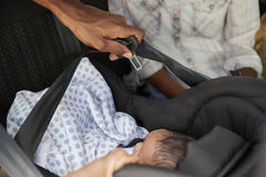 Close Up Of Parents Bringing Newborn Baby Home In Car Royalty Free Stock Photos