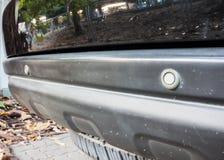 Sensor at rear car bumper. Close up parking sensor at rear car bumper Royalty Free Stock Photo