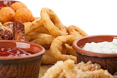 Close up of the part of appetizers to beer -  fried squid rings, Royalty Free Stock Photo