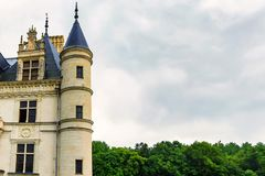 Part of Chateau de Chenonceau and sky. Close up part of beautiful medieval castle Chateau de Chenonceau in France and grey sky background stock photos