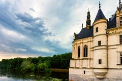 Part of Chateau de Chenonceau and river. Close up part of beautiful medieval castle Chateau de Chenonceau in France and river beside it royalty free stock photo