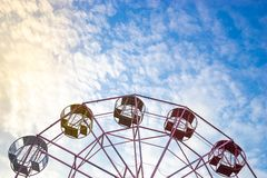 Close up part of pastel Ferris wheel on blue sky stock image