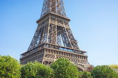 Close up of a part of Eiffel tower against a bright blue sky , Paris , France royalty free stock images