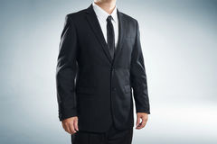 Close up part of man body in black suit Stock Images