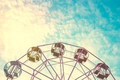 Part of pastel ferris wheel on blue sky,. Close up part of pastel Ferris wheel on blue sky, filter Instagram stock photo