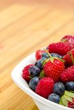 Close up of part of plate full of berries on the table Stock Photography