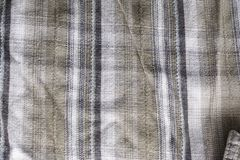 Close up part of a shirt from hemp fabric. Casual man`s shirt with pattern. Wrinkled texture from hemp and cotton background.  royalty free stock image