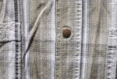 Close up part of a shirt from hemp fabric. Casual man`s shirt with pattern. Wrinkled texture from hemp and cotton background.  royalty free stock images