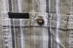 Close up part of a shirt from hemp fabric. Casual man`s shirt with pattern. Wrinkled texture from hemp and cotton background.  stock photo