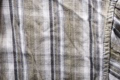 Close up part of a shirt from hemp fabric. Casual man`s shirt with pattern. Wrinkled texture from hemp and cotton background.  royalty free stock photos