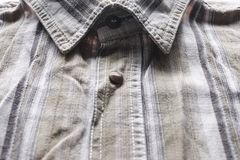 Close up part of a shirt from hemp fabric. Casual man`s shirt with pattern. Wrinkled texture from hemp and cotton background.  stock images