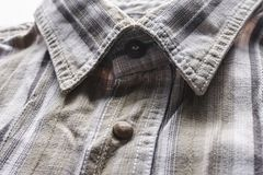Close up part of a shirt from hemp fabric. Casual man`s shirt with pattern. Wrinkled texture from hemp and cotton background.  stock photography