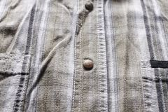 Close up part of a shirt from hemp fabric. Casual man`s shirt with pattern. Wrinkled texture from hemp and cotton background.  royalty free stock photo