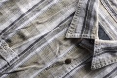 Close up part of a shirt from hemp fabric. Casual man`s shirt with pattern. Wrinkled texture from hemp and cotton background.  stock photos