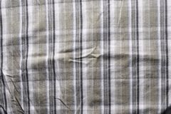 Close up part of a shirt from hemp fabric. Casual man`s shirt with pattern. Wrinkled texture from hemp and cotton background.  stock image