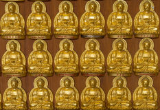 Close up a part of ten thousand golden buddhas lined up Royalty Free Stock Photo