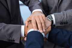 Close-up partial view of businesspeople in formal wear stacking hands together Stock Photo