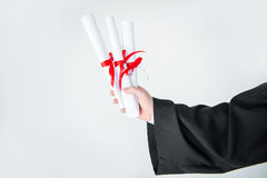 Close-up partial view of student holding diplomas Royalty Free Stock Photos