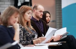 Close up.the participants of the seminar in the conference room. Business and education stock photography