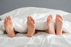 Close Up Partners Soles On White Bed Stock Image
