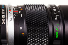 Close-up of parts of a camera lens. 135mm telephoto lens close-up, showing shutter speeds, focus ring and aperture ring Stock Photography