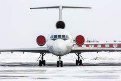Close up of passenger airliner. In a cold winter airport Royalty Free Stock Photography