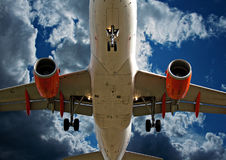 Close up of passenger plane landing Royalty Free Stock Photos