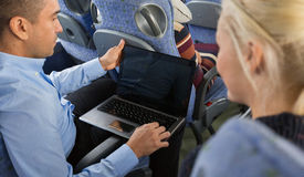 Close up of passengers with laptop in travel bus Royalty Free Stock Photo