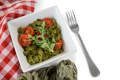 Close up of pasta in bowl by napkin Stock Photography