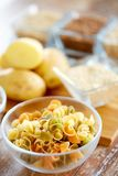 Close up of pasta in glass bowls on table Royalty Free Stock Photos