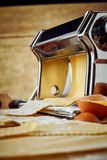 Close up on pasta making press and eggshell Royalty Free Stock Photography