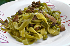 Close up of pasta with mushroom and peas Stock Photo